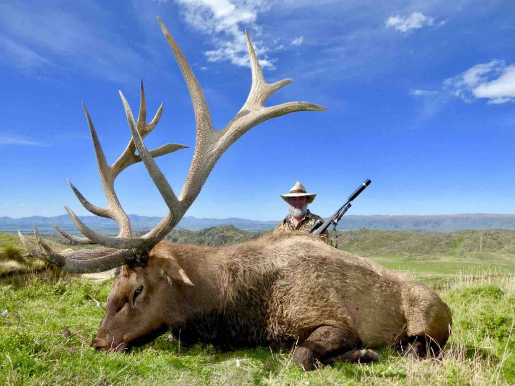 Picture of a man and the elk he hunted
